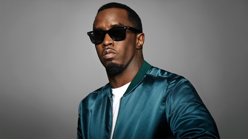 DIDDY SKYDIVES AND LANDS OUTSIDE THE PLAYBOY MANSION FOR HIS 49TH BIRTHDAY